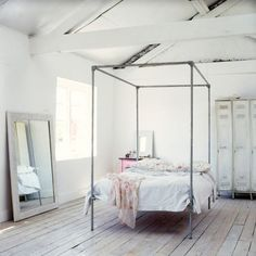 This four poster bed creates a great focal point for such a large space... if you can place it right in the middle of the room.