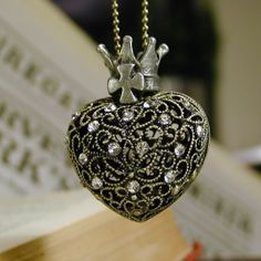 Crowned and bejeweled black heart locket.  Valentines Day gift.