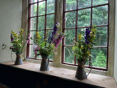 Jugs of summer garden flowers, perfect for a country church wedding