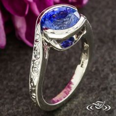 Design Your Own Unique Custom Jewelry at Green Lake Jewelry Works! Custom Platinum half wrap design with open sides to see sapphire cutlet hand engraved scroll details with flush set diamonds on sides milgrain edges
