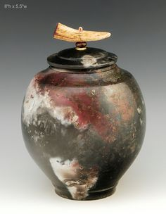 Pit fired raku covered jar, Ron Mello