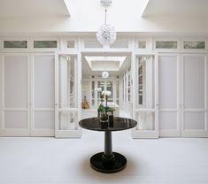 In the dressing room, four custom closets keep Gwyneth Paltrow's red carpet-worthy wardrobe tucked away.