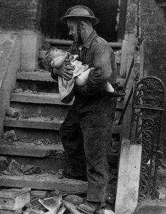Air-raid warden and baby girl during the Blitz in London, WW2.