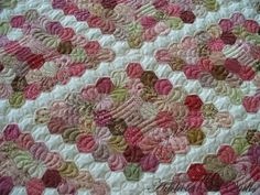 Addicted to Quilts blog: Pink hexagon quilt.  Love the machine quilting that was done on this quilt.