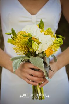 Maybe a small floral bouquet for bridesmaids and each one has one brooch to tie into yours?