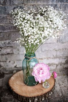 I love the idea of having the baby's breath in blue mason jars as part of the centerpieces at the reception.