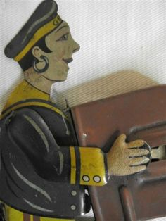 detail of penny toy whistle,sailor playing accordion, early 20th century, German