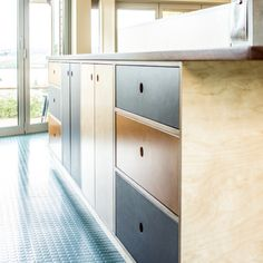 Retro style plywood kitchen with coloured drawer fronts