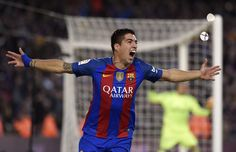 Barcelona's Uruguayan forward Luis Suarez celebrates a goal during the Spanish league football match FC Barcelona vs Real Madrid CF at the Camp Nou stadium in Barcelona on December 3, 2016. / AFP / LLUIS GENE