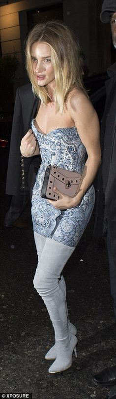 Paisley princess: Rosie donned a strapless printed dress for the party...