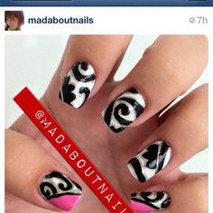 black swirls on white nail art design