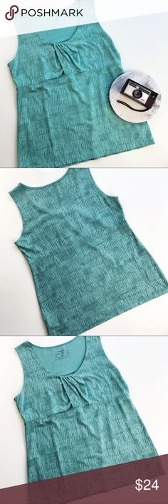 """Patagonia Athletic Top Mint Aqua Tank Size XL Patagonia sleeveless top, for fitness or everyday active wear. Mint aqua print (cross hatch squares). Size XL Underarm to underarm: 19"""" Length, shoulder seam to bottom hem: 27"""" Inventory AA14 Patagonia Tops Tank Tops"""