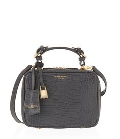 <p>For an itty bitty pretty bag, the Waldorg Croco Top Handle Crossbody is all business. Crafted with exotic crocodile embossed leather and adorned with lock and key charms and custom Henri Bendel feet and hardware, this designer bag is this season's pick for Bendel Girls in the know.</p>