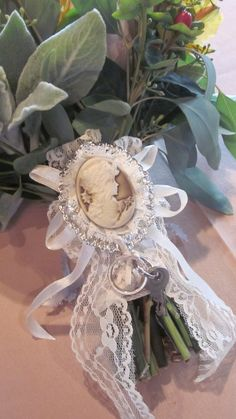 Put a vintage broach on your wedding bouquet for something old!