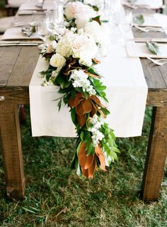 Magnolia Leaf Garland Table Runner (with roses, etc.) -- See more here: http://www.StyleMePretty.com/2014/04/14/elegant-tennessee-plantation-wedding/ Photography: AustinGros.com -- Floral Design: EnchantedFloristTn.com