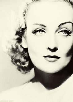Carole Lombard had iconic beauty & her makeup was minimal yet sculpted to show of the curves of her lips and cheekbones (highlighted powder & foundation) curled lashes & mascara, sculpted, narrow brow lines.
