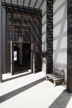 Sunlight and shadows in the monochromatic entrance of Piet Boon villa in Bonaire, Kralendijk, Caribbean Netherlands