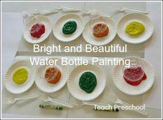 Painting. Bottom of bottle for flowers, fork for grass an sun