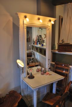 Old door with a mirror, spindle legs and lights added and repurposed into a make-up table.