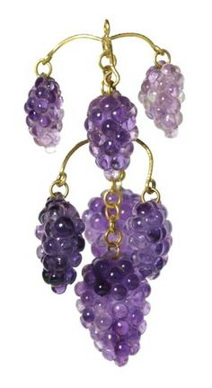 A pendant of amethyst and enamelled gold in the form of a grapevine. Seven amethysts, carved and polished to represent bunches of 'black' grapes, hang from tiered sprigs of recurving wire and a short length of chain. Part of the Cheapside Hoard, late 16th-early 17th century.