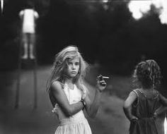 I remember seeing this many moons ago and being completely enthralled by the knowing look on her face and thinking about how tall she would grow up to be. Frankly, it scared the crap out of me. Also, for some reason I always thought it was French but it was taken by American photographer Sally Mann.