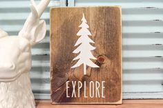 Perfect for the woodland nursery or childrens room decor! Cute rustic wood sign, Explore, designed & handcrafted by Three Arrows. We use non toxic acrylic paint (NO STICKERS) on stained wood and distressed for a rustic look. Wall hook on back for easy hanging! This listing is for (1) EXPLORE sign. SIZE: APPROX. 8x10 inches (+/-).  PLEASE NOTE: Each sign is hand cut and size may vary ever so slightly :)  Our signs start with the design process. All of our creations are designed and m...