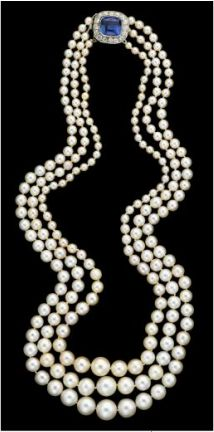 Platinum, natural pearl, diamond and sapphire necklace, Cartier from the workshop of Henri Picq. Triple strand graduated pearl necklace. French hallmarks on clasp, signature of the maker and maker's hallmark of Henri Picq. L: 30 in.