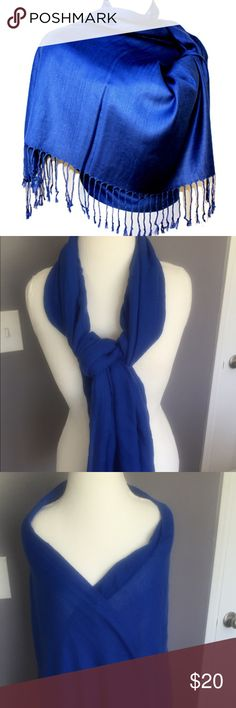 Pashmina Scraf New  without tag. Beautiful Pashmina scarf made of 70% wool and 30% silk .   28 x 80 length and about  3 inch tassels. No holes or tears. Never worn Pashmina Accessories Scarves & Wraps