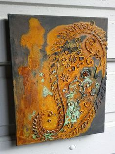 Original reactive artwork.    Name: Jewel  Size: 11 x 14 x .5 deep Stretched canvas.  This is part of my metal effects finishes series. Iron background (almost chalk color) with reddish orange rust finish and patina. Raised paisley design with faux jewel.  Canvas is ready to hang, no frame needed!  Canvas comes wrapped in clear poly bag and natural raffia ribbon for gifting.  All art is signed by artist.    My original reactive finishes are made using a combination of a rust and/or patina…