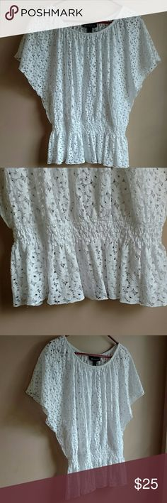 Beautiful Summer Top NWOT Beautiful summer top with an eyelet theme by I-N-C International Concepts! Never worn with elastic below the waist. Short flowing sleeves! Beautiful piece! Size Small.  58% Cotton  42% Nylon I-N-C International Concepts  Tops Blouses