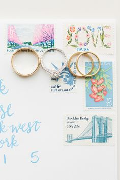 RIngs on envelope with cute and colorful stamps for wedding LOVE stamp | Ashley Caroline Photography