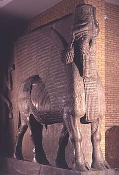 Assyrian guardian figure: This colossal statue, 4.42m (14ft 6in) high and weighing some 30 tons, was one of a pair guarding a gate at Dur Sharrukin, founded by the Assyrian king Sargon II (721-705 BC). The city was abandoned by Sargon's son Sennacherib, who moved the capital to nearby Nineveh.