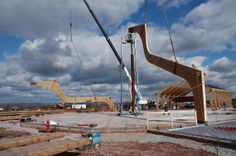 Hauling up glulam arches by Unalam for the Bethel Woods Center museum.