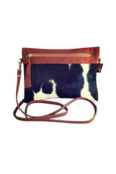 This is stylish, yet very versatile cowhide sable clutch and cross body bag features luxurious tan lambskin leather on one side and natural hair on hide cowhide on the other. This is a bag that you mu