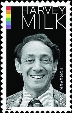 The stamp, which was revealed on Linn's Stamp News, features the colors of the pride flag and a black-and-white photo of the politician. | Harvey Milk Will Be The First Openly Gay Official To Appear On A U.S. Stamp