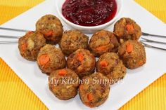 """Stuffing Meatballs - for this appetizer I used the leftover sausage stuffing. I used 2 cups of stuffing, one egg and mix everything together. Shape it into small balls and fried until golden brown. Voila!! Served with some leftover cranberry sauce."""