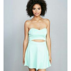 The ANNIE Sweetheart Mint Dress Get that must have two piece look with the ease of a one piece dress! Features a stretchy knit body, a strapless sweetheart neckline, an open waist, and skater skirt. Bust is lined.  Material: Polyester,  Rayon, Spandex. Dresses