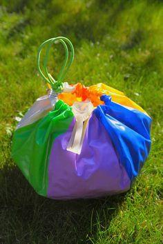 Turn a beachball into a beach tote! This is a great idea for a beach ball that no longer holds air.