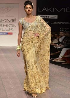 Model walks the ramp in gold lace saree for Bhairavi Jaikishan at Lakme Fashion Week 2013