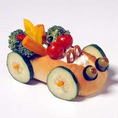 For kids' parties, build a little auto as centerpiece and healthful eats. Scoop dip into the bun, surround it with crisp colorful veg, and invite kids to dip, crunch, and dismantle if needed.
