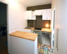 Can You Spot It? Top-Loading Washing Machine Hidden in the Kitchen Studio D'Archi | Apartment Therapy
