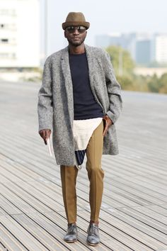 Subtle layering moves the mens styling look forward for #streetstyle spotted outside #PFW #ss15