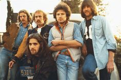 The Eagles are, standing left to right, Don Felder, Bernie Leadon, Don Henley, and Randy Meisner, with guitarist Glenn Frey kneeling....