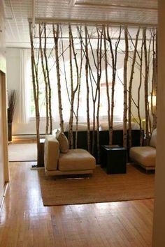 Separador d ambientes con ramas