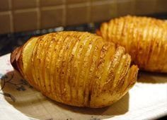 Spicy Hasselback Potatoes ~T~ Love the seasoning in these. Paprika, cumin, salt and cayanne pepper.  ( a hint to cut potatoes. Put a pencil on each side of the potato and the knife will hit the pencils to keep you from cutting through to the bottom)