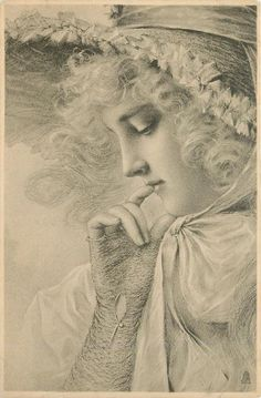 close up of woman, facing left, gloved hand to her face