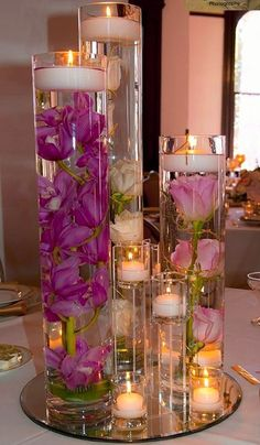 Pink Star Flower Floral Wedding Centerpiece with Floating Candles an. Submersible Pink Star Flower Floral Wedding Centerpiece with Floating Candles an. - -Submersible Pink Star Flower Floral Wedding Centerpiece with Floating Candles an. Floating Candle Centerpieces, Wedding Table Centerpieces, Wedding Flower Arrangements, Floral Centerpieces, Wedding Decorations, Centerpiece Ideas, Diy Candles, Candle Wax, Graduation Centerpiece
