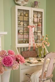 Shabby chic desk filled with vintage collections Image Source