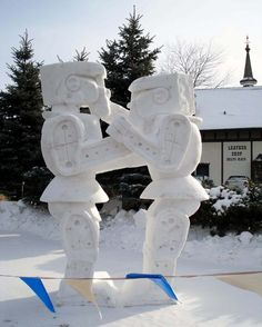 These rock 'em, sock 'em snow-bots. | 29 Seriously Cool Snow Sculptures That Will Make You Want Another Storm