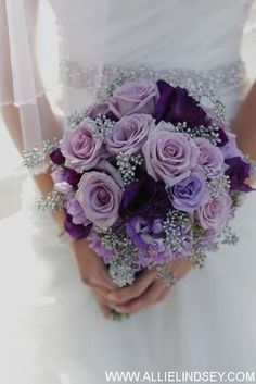 Purple Wedding. Bridal Bouquet of Roses, Lisianthus, Moon Series Carnations and Seeded Eucalyptus. Purple, Lavender and Silver - Simply Regal by Julie. Photo courtesy of Allie Lindsey Photography